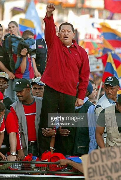 Venezuelan President Hugo Chavez greets progovernment marchers 23 January in Caracas on the 53rd day of a general strike demanding his resignation...