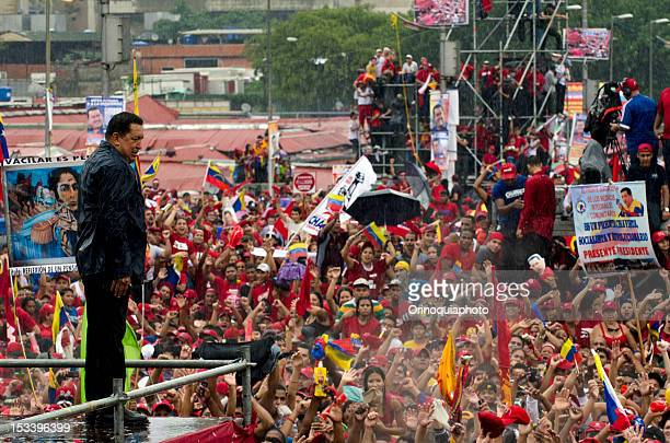 Venezuelan president Hugo Chavez greets the crowd during the closing rally of his campaign at Bolivar Avenue on October 04 2012 in Caracas Venezuela...