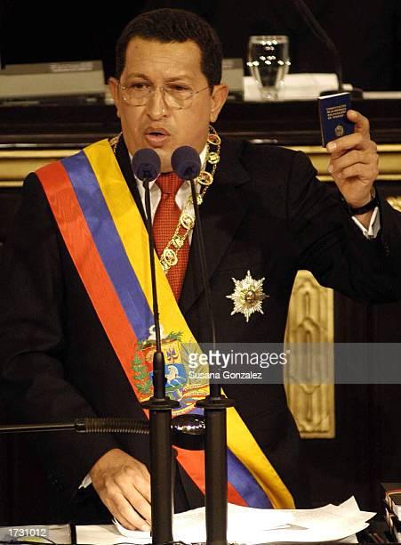 Venezuelan President Hugo Chavez holds up the Venezuelan Constitution as he speaks before the National Assembly for his annual speech January 17 2003...