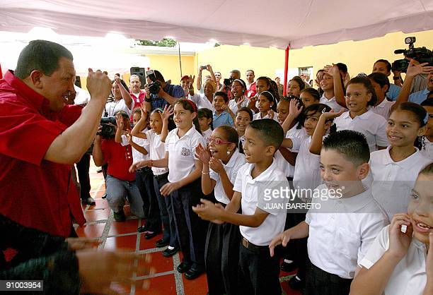 Venezuelan President Hugo Chavez jokes around with public school children in Caracas on September 21 2009 Chavez allegedly spoke to ousted Honduran...