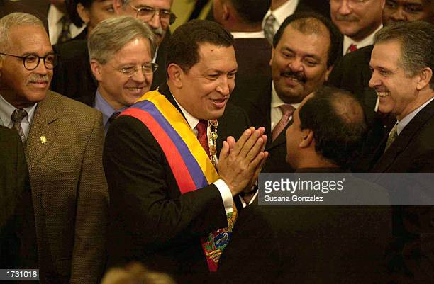 Venezuelan President Hugo Chavez jokes with visiting ambassadors as he arrives at the National Assembly to deliver his annual address January 17 2003...