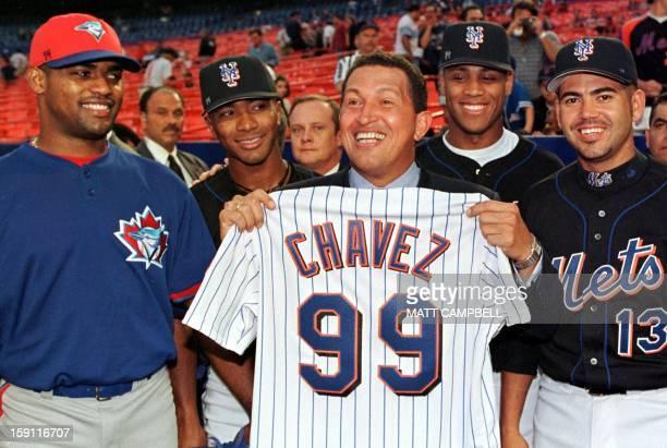 Venezuelan President Hugo Chavez poses with Venezuelan Major League Baseball players Kelvim Escobar of the Toronto Blue Jays and New York Mets...