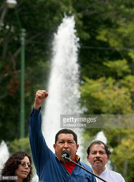 Venezuelan President Hugo Chavez raises his fist during a speech alongside his Nicaraguan counterpart Daniel Ortega during an official visit to the...