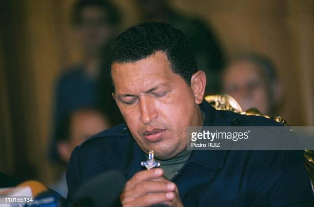 Venezuelan President Hugo Chavez returns to office two days after he was ousted from the Palace of Miraflores and arrested by the military in Caracas...