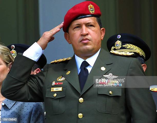 Venezuelan President Hugo Chavez salutes during a ceremony in Caracas 01 February 2001 honoring the 184th anniversary of the birth of the...