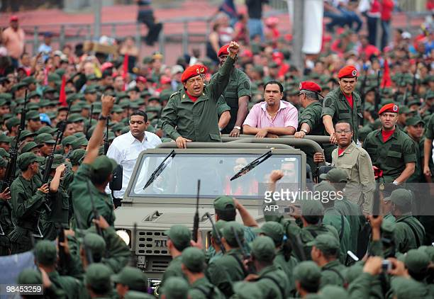 Venezuelan President Hugo Chavez salutes during a ceremony to commemorate the eighth anniversary of the failed coup d'etat against him on April 13...