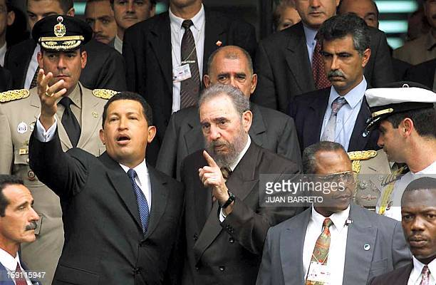 Venezuelan President Hugo Chavez salutes next to Cuban President Fidel Castro under the strict measures after finishing a program of video conference...
