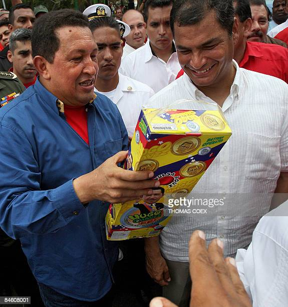 Venezuelan President Hugo Chavez shows a doll portraying himself given to him by a supporter to his Ecuadorean counterpart Rafael Correa during a...