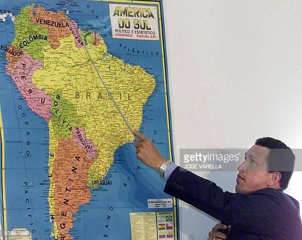 Venezuelan President Hugo Chavez shows a map of South America to explane Venezuelan border problems that he maintains with Guyana during a press...