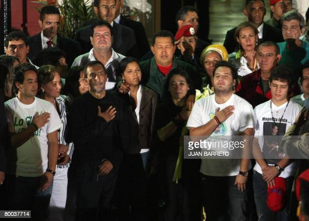 Venezuelan president Hugo Chavez sings the national anthem accompanied by the Colombian hostages released by the FARC at the Miraflores presidential...
