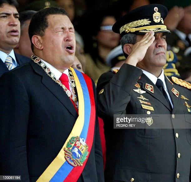 Venezuelan President Hugo Chavez sings Venezuela's national anthem beside Defense mnister Raul Baduel during a military parade on January 10th in...