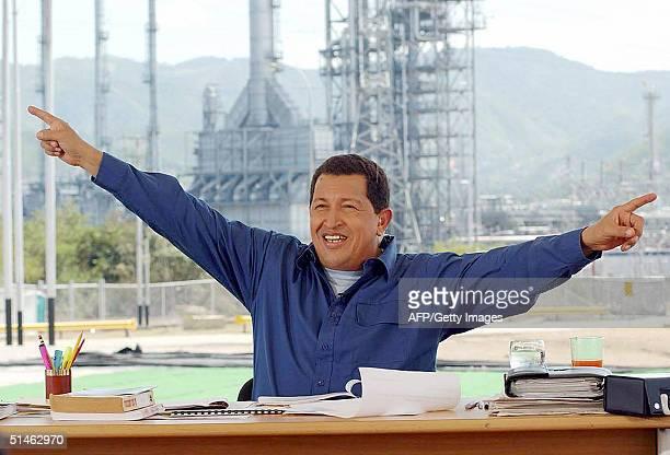 Venezuelan President Hugo Chavez speaks during the weekend radio program 'Alo Presidente' in Puerto La Cruz west of Caracas 10 October 2004 Chavez...