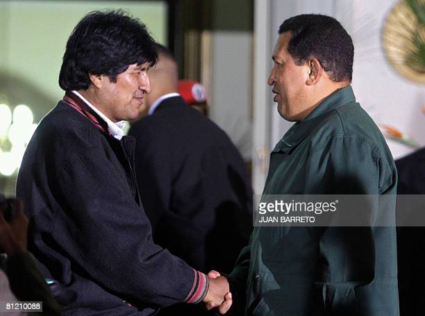 Venezuelan President Hugo Chavez speaks with his Bolivian counterpart Evo Morales at Miraflores presidential palace in Caracas on May 22 2008 Morales...
