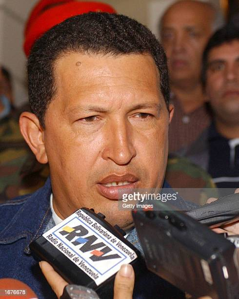 Venezuelan President Hugo Chavez speaks with the media December 7 2002 in Caracas Venezuela President Chavez is calling on the opposition to return...