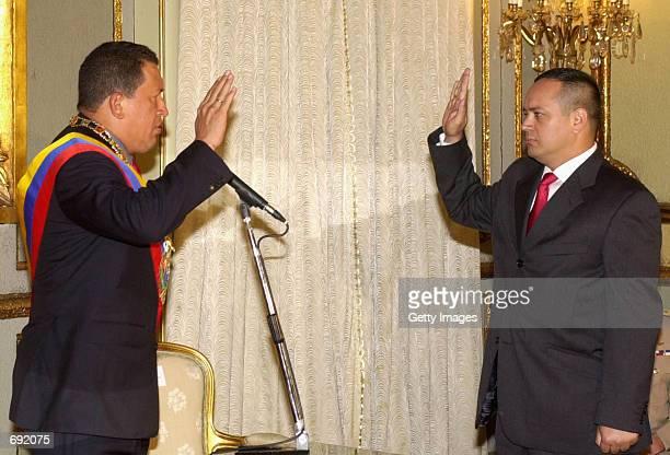 Venezuelan President Hugo Chavez swears in Diosdado Cabello as the new vice president January 17 2002 at the presidential palace in Caracas Venezuela...