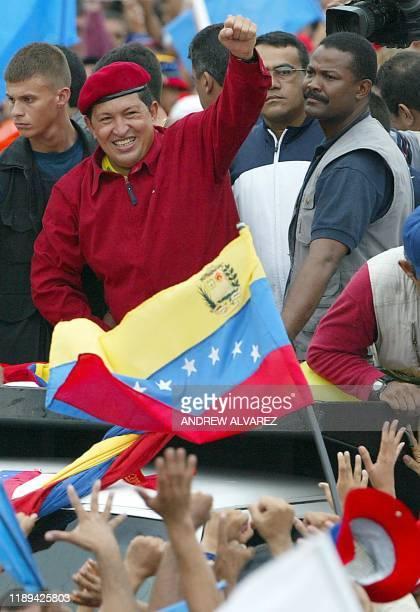 Venezuelan President Hugo Chavez waves to supporters 29 June 2002 in Caracas Venezuelan Vice President Jose Vicente Rangel said 29 June 2002 the...