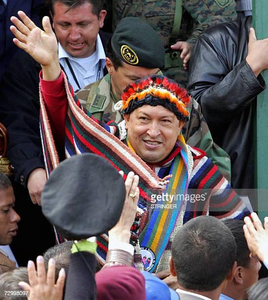 Venezuelan President Hugo Chavez wears a costume of Ecuadorean Huaorani tribe during ceremony, 14 January in Zumbahua village, Cotopaxi Province,...