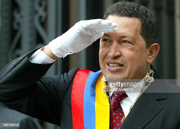 Venezuelan President Hugo Chávez looks towards a crowd of supporters during a ceremony marking Simon Bolivar's 219th birthday in Caracas 24 July 2002...