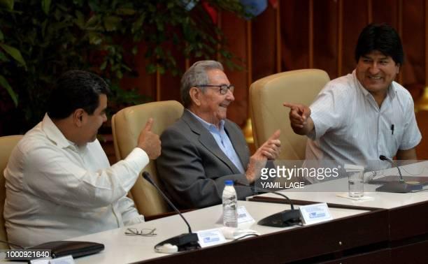 TOPSHOT Venezuelan President Nicolas Maduro and Bolivian Evo Morales joke next to Cuban former President Raul Castro during the XXIV Forum of Sao...