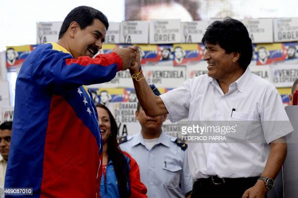 Venezuelan President Nicolas Maduro and Bolivian President Evo Morales greet each other during a rally at the Miraflores presidential palace in...