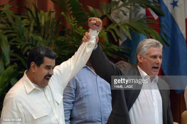 Venezuelan President Nicolas Maduro and Cuban President Miguel DiazCanel wave during the XXIV Forum of Sao Paulo meeting in Havana on July 17 2018