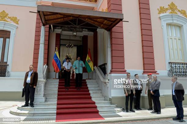 Venezuelan President Nicolas Maduro and his Bolivian counterpart Evo Morales address the media after holding a meeting at the Miraflores presidential...