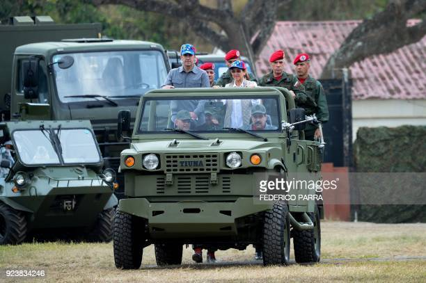 Venezuelan President Nicolas Maduro arrives driving the vehicle for military exercises at Fort Tiuna accompanied by First Lady Cilia Flores Vice...