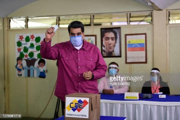 Venezuelan President Nicolas Maduro casts his vote at a polling station in the Simon Rodriguez school in Fuerte Tiuna, Caracas, on December 6, 2020...
