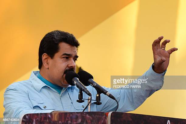 Venezuelan President Nicolas Maduro delivers a speech before supporters gathering outside the presidential palace in Caracas on March 18 2015 Leaders...