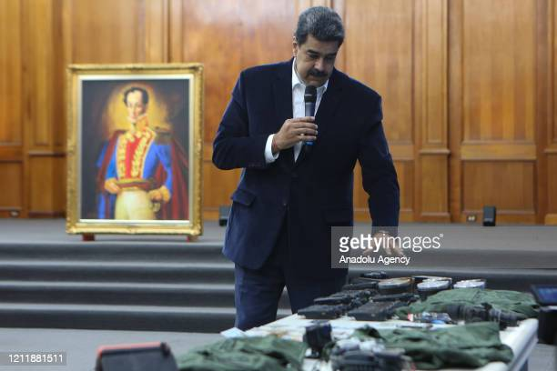 Venezuelan President, Nicolas Maduro displays seized armament and passports after a meeting with members of the Armed Forces in Caracas, Venezuela on...