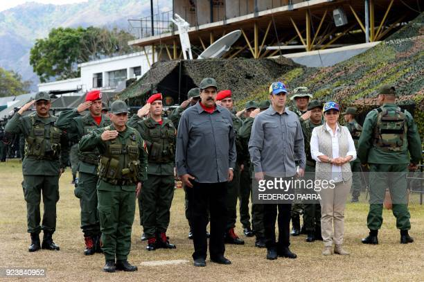 Venezuelan President Nicolas Maduro First Lady Cilia Flores and Vice President Tarek El Aissami receive military honors upon their arrival for the...