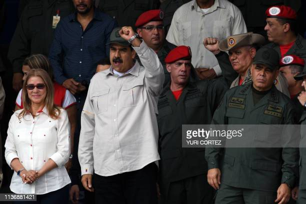 Venezuelan President Nicolas Maduro flanked by his wife Cilia Flores and Venezuela's Defense Minister Vladimir Padrino attends the commemoration of...
