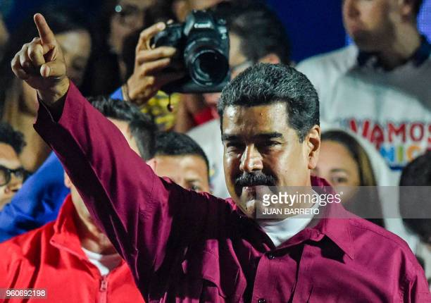 Venezuelan President Nicolas Maduro gestures after the National Electoral Council announced the results of the voting on election day in Venezuela on...