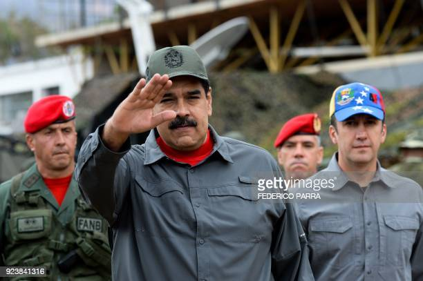 Venezuelan President Nicolas Maduro gestures as he arrives for the military exercises at Fort Tiuna in Caracas on February 24 2018 / AFP PHOTO /...