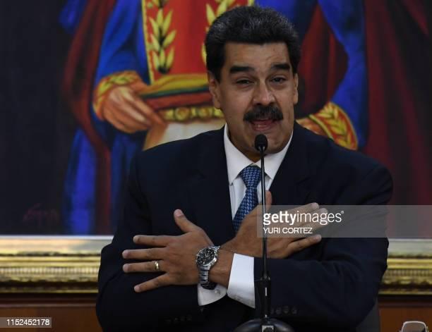 Venezuelan President Nicolas Maduro gestures as he speaks during the Simon Bolivar national journalism award ceremony at Miraflores presidential...