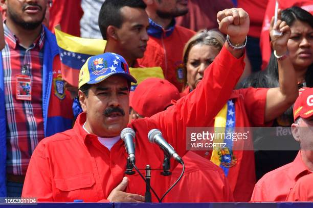 Venezuelan President Nicolas Maduro gestures during a gathering to mark the 20th anniversary of the rise of power of the late Hugo Chavez the leftist...