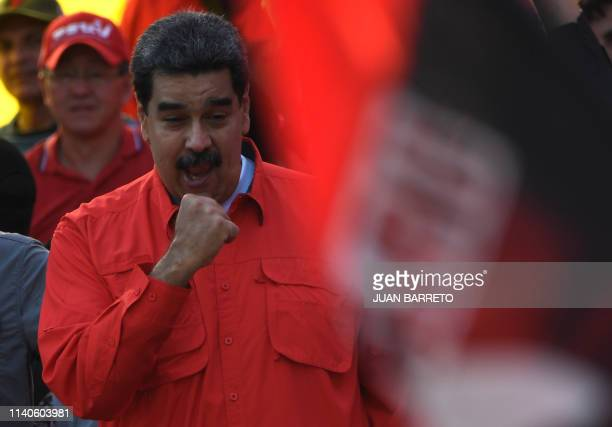 TOPSHOT Venezuelan President Nicolas Maduro gestures during a May Day rally in Caracas on May 1 2019 Opposition supporters demonstrated for a second...