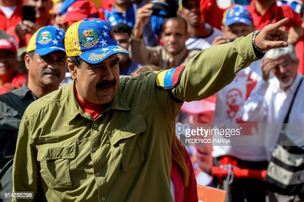 Venezuelan President Nicolas Maduro greets supporters during a rally to commemorate the 26th anniversary of late Venezuelan President Hugo Chavez's...