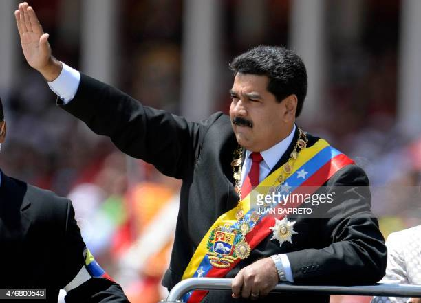 Venezuelan president Nicolas Maduro greets to supporters before a military parade in Caracas on March 5 2014 The Venezuelan government on Wednesday...