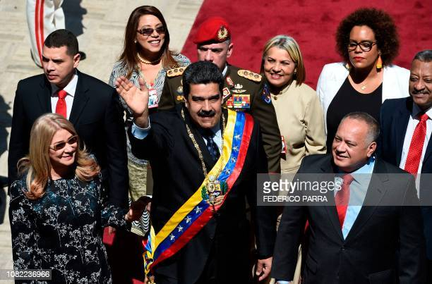 TOPSHOT Venezuelan President Nicolas Maduro his wife Cilia Flores and the president of the Constituent Assembly Diosdado Cabello arrive at the...