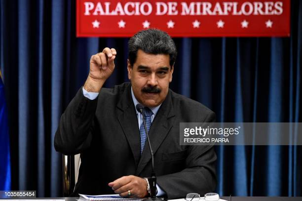 Venezuelan President Nicolas Maduro imitates a gesture allegedlly done by celebrity Turkish chef Nusret Gokce a social media star chef who goes by...