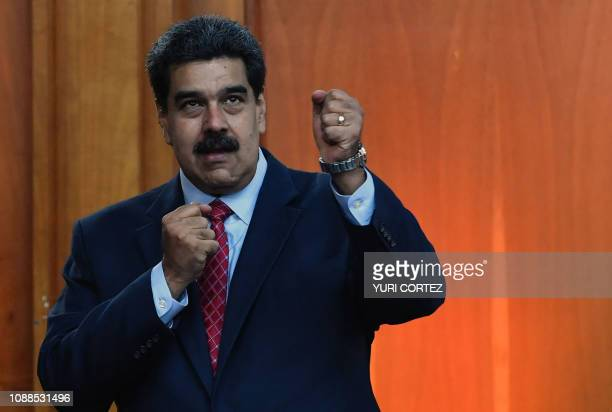 Venezuelan President Nicolas Maduro leaves after offering a press conference in Caracas on January 25 2019 Venezuela's opposition leader Juan Guaido...