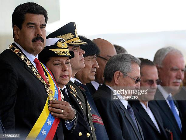 Venezuelan president Nicolas Maduro looks on before a military parade next to Bolivian President Evo Morales and Cuban President Raul Castro in...