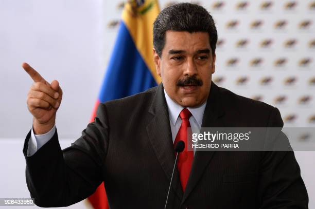 Venezuelan President Nicolas Maduro offers a press conference after the signing of the electoral guarantee agreement between the government and...