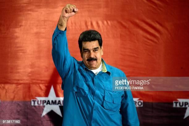 TOPSHOT Venezuelan President Nicolas Maduro raises his fist during a rally in Caracas on February 3 2018 Venezuelan President Nicolas Maduro urged...
