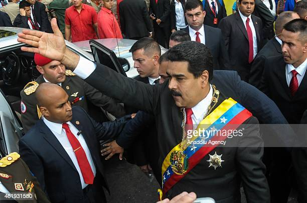 Venezuelan President Nicolas Maduro salutes the people as he arrives at the parliament to give his annual speech to the nation in Caracas on January...