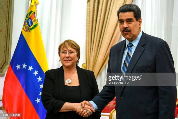 TOPSHOT Venezuelan President Nicolas Maduro shakes hands with Chilean High Commissioner for Human Rights Michelle Bachelet at Miraflores Presidential...