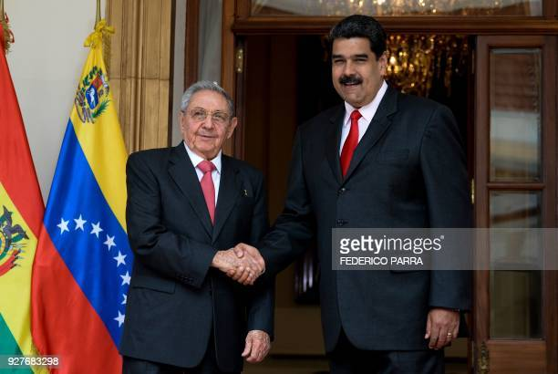 Venezuelan President Nicolas Maduro shakes hands with Cuban President Raul Castro during the Bolivarian Alliance for the Peoples of Our America...