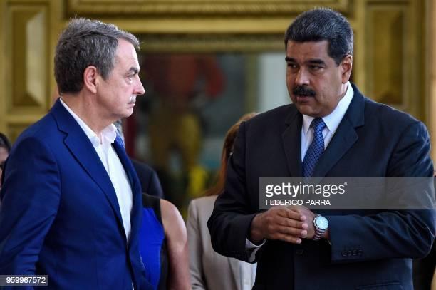 Venezuelan President Nicolas Maduro speaks with the former president of Spanish government Jose Luis Rodriguez Zapatero at the Miraflores...