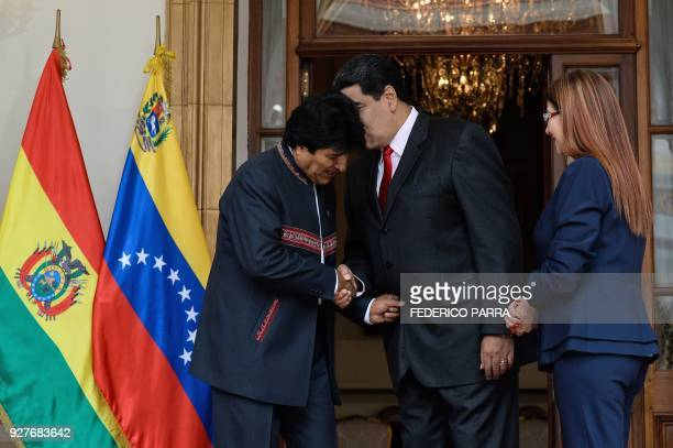 Venezuelan President Nicolas Maduro talks to his Bolivian counterpart Evo Morales next to Venezuelan First Lady Cilia Flores during the Bolivarian...